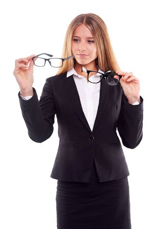 decides: Pensive businesswoman with glasses,on white background Stock Photo