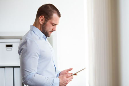 bussines: Businessman using digital tablet computer in the office Stock Photo