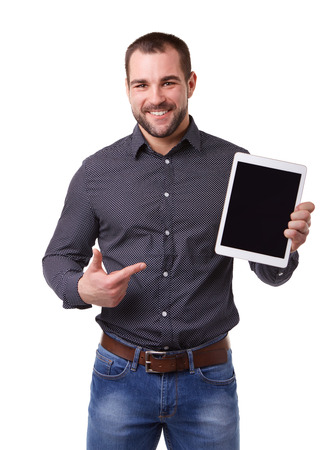happy young man: Businessman in black shirt shows touch screen. Isolated over a white background