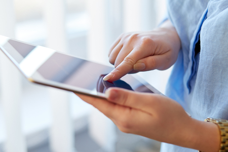 Woman holding white digital tablet, view close up Stock Photo