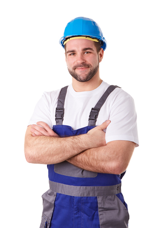 worker working: Worker in working clothes with crossed arms Stock Photo
