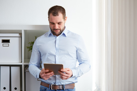man shirt: Businessman using digital tablet computer in the office Stock Photo