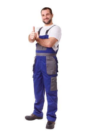 happy workers: Full length portrait of a manual worker makes a gesture thumbs up Stock Photo