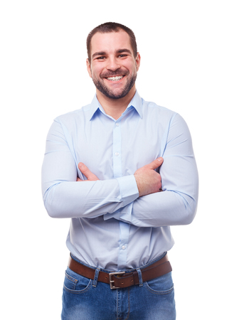 blue shirt: Smiling man in blue shirt with crossed arms. Isolated on white background Stock Photo