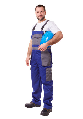 Male construction worker with blue helmet and uniform Stockfoto