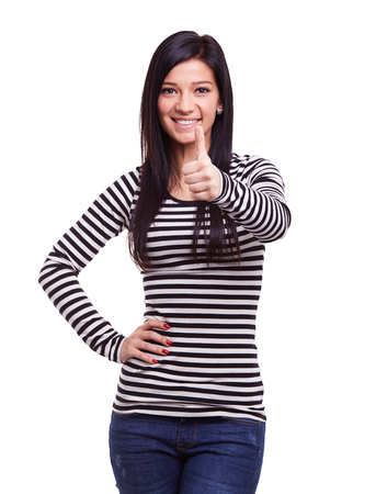 attractive  female: Young woman doing ok gesture with thumb up Stock Photo