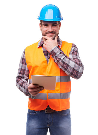 Manual worker in blue helmet with digital tablet, isolated on white. Banque d'images
