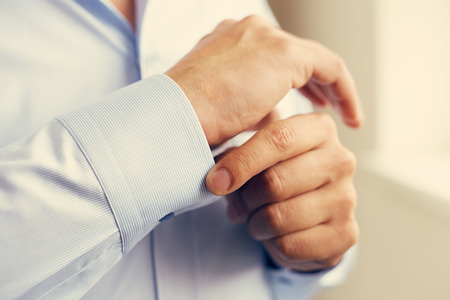 made to measure: Man dressed in striped shirt, sleeve close up. Toned