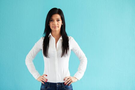 hip: Business woman standing with hands on hips