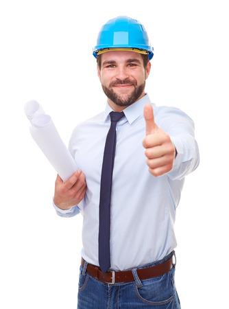 arquitecto de negocios con el casco y el plan, hace un gesto con el pulgar hacia arriba sobre fondo blanco Foto de archivo