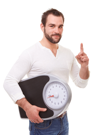 reproach: Young man holding scale weight and reproaching