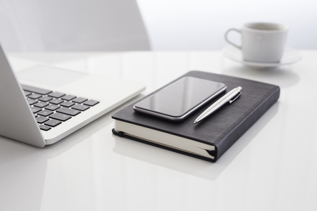 laptop computers: Workplace with open laptop, diary, mobile phone and coffee
