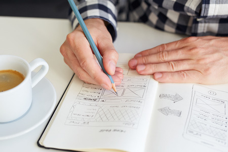 Man draws a sketch graphic design for website Stock Photo