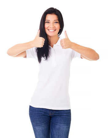 women in jeans: Smiling young woman with thumbs up, on a white background Stock Photo