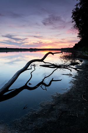 Beautiful sunset on the lake with reflections Stock Photo