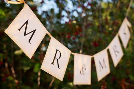 Mr. & Mrs. wedding sign on the flags