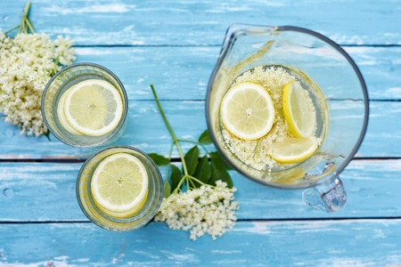Two glasses and a jug of elderflower lemonade, top view Stock Photo