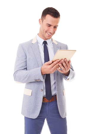 Businessman using tablet pc. Isolated over a white background