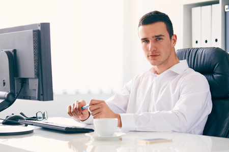 Young businessman working in the office, toned