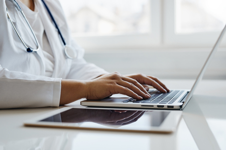 Female doctor working with her laptop in the office