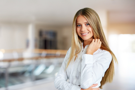 Young woman in a business center on the corridor