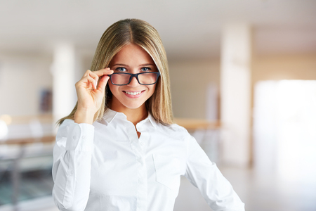 Portrait of a beautiful woman with glasses in a business center Reklamní fotografie