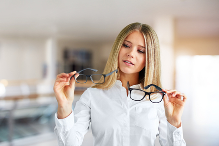 Pensive woman with glasses in a business center Reklamní fotografie