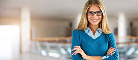 Happy businesswoman with glasses in business center