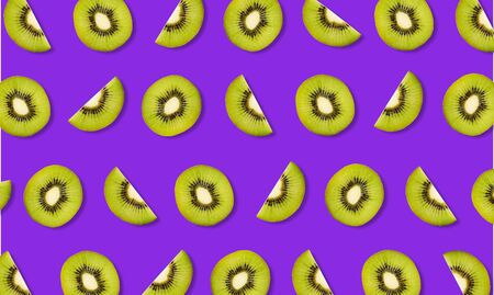 Top view of fruit pattern from slices of kiwi on purple background 写真素材