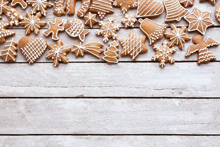 Homemade Christmas gingerbread cookies on white wooden table