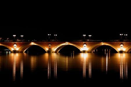 Night view of The Pont de pierre (Stone Bridge) (1819-1822), Bordeaux, France photo