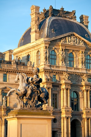 The Louvre Palace and Equestrian statue of Louis XIV before sunset, Paris, France