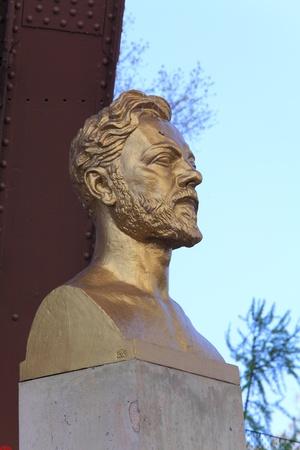 Statue of Gustave Eiffel near Tower, Paris, France photo