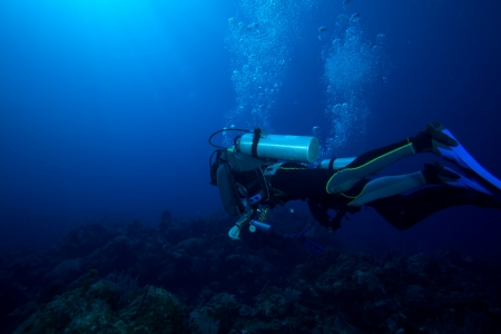 underwater diving: Two divers with air-bublles, Cuba Stock Photo