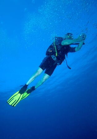 Diver with bright yellow fins photo