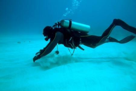 Diver near sand bottom, Cuba photo