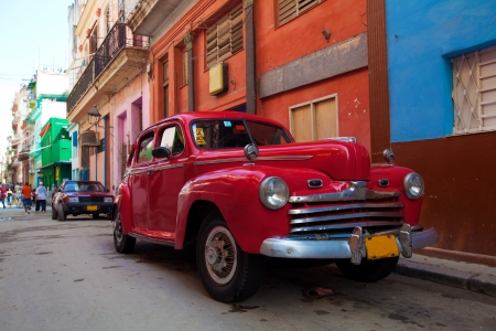 Vintage red car on the street of old city, Havana, Cuba Stock Photo - 15246499
