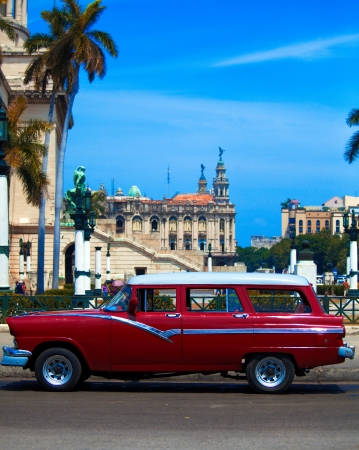 Vintage red car on the street of old city, Havana, Cuba photo