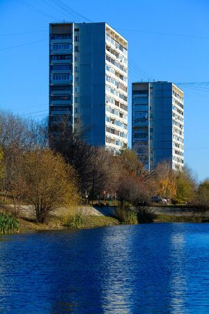 Apartment buildings mirrored in pond at autumn, Chertanovo Centralnoe, Moscow Stock Photo - 15246456