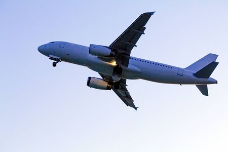 Airplane in evening sky Stock Photo - 15370994