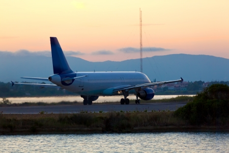 Airplane before take-off, evening scene, Corfu photo