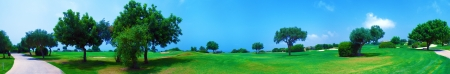 shot put: Wide panorama of golf field with sea and olive trees,  Paphos, Cyprus