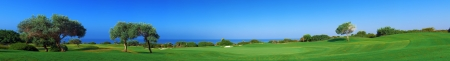 Wide panorama of golf field with sea and olive trees,  Paphos, Cyprus