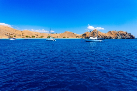 Traditional Vintage Small Boat in Ocean, Komodo, Indonesia photo