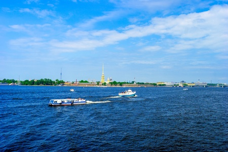Peter and Paul Fortress and Neva River with touristic boats, St.Petersburg photo