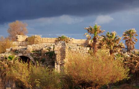 caesarea: Ruins of Antique Harbor before Sunset, Caesarea Maritima, Israel Stock Photo