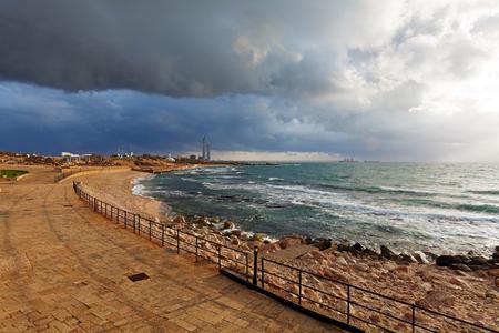 Sea Coast and Ruins of Caesarea Maritima before Sunset, Israel photo