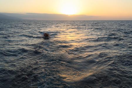komodo island: Ocean Sunset with Boat, Komodo Island Stock Photo