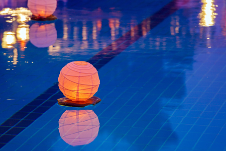 pool table: Floating water lantern in the pool Stock Photo
