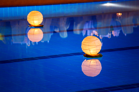 pool symbol: Floating water lantern in the pool Stock Photo